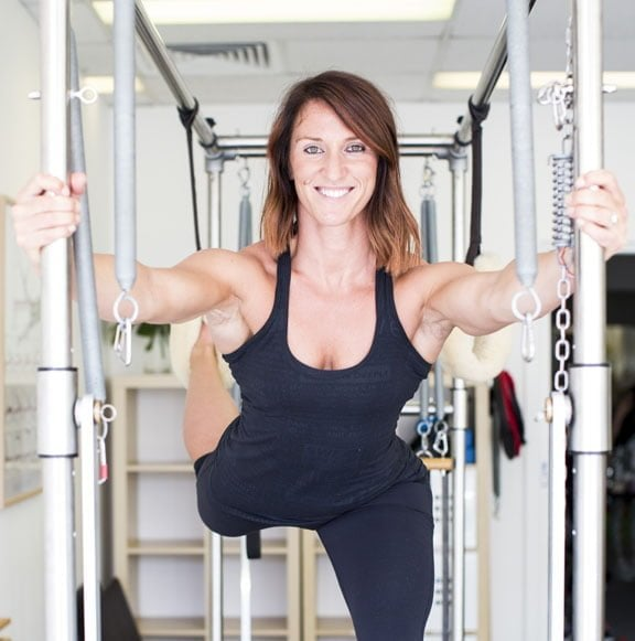 Woman doing pilates exercises for fitness goals