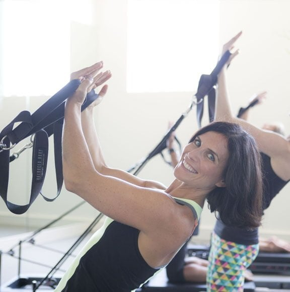 Women doing reformer exercises